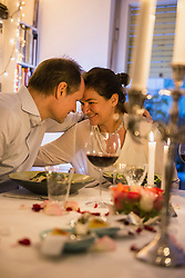 Couple head to head at candlelight dinner