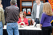 "Dec. 1, 2009 -- TEMPE, AZ: Former Alaska Governor SARAH PALIN signs copies of her book, ""Going Rogue"" at a Costco in Tempe, AZ, Tuesday. More than one thousand people showed up for the signing. About 150 of them spent the night at the store. Palin did not make any comments or speak to the address during her appearance in Tempe.  Photo by Jack Kurtz"