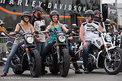 A family that rides together stays together! With help from Harley-Davidson's Justin Stahl, parents Lonnie Leech and Tammy McGhee of College Park, GA try out new 2016 V-Rods with their daughter Heather at the free Demo ride area at the Harley-Davidson Foot Print at Daytona International Speedway during Daytona Bike Week's 75th Anniversary event. FL, USA. Saturday March 12, 2016.  Photography ©2016 Michael Lichter.