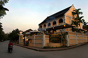 In the late 1800s, French colonial powers and the Lao aristocracy of Vientiane developed a new architectural fusion in Luang Prabang, inspired by local temples and materials, and French and Indochine architecture. The French brought in skilled Vietnamese builders to build two-storey villas throughout the town.