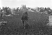 Woodstock Rock Festival fans on a muddy hill at the Woodstock rock festival at Max Yasgur's 600 acre farm, in the rural town of Bethel, NY, on the weekend of August 16-18, 1969.