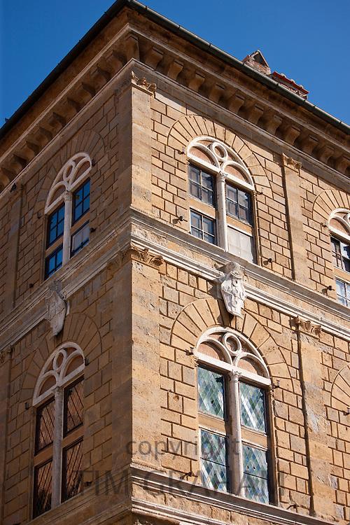 Stained glass leaded light windows of Palazzo Piccolomini in Via Del Balzello, in Pienza, Tuscany, Italy