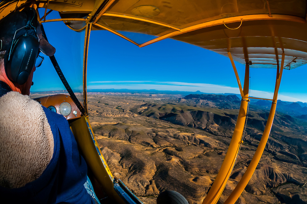 A 1948 Piper J-3 Cub flying above the Chihuahuan Desert near Big Bend National Park, Texas USA.