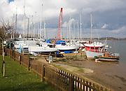 Boats in boatyard on River Deben, Waldringfield, Suffolk, England