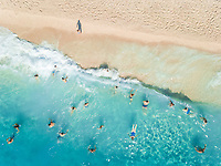 NIKITAS, GREECE - 13 JULY 2018: Aerial view of people enjoying the swimming in the sea on sandy beach.