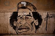 Anti-Qadaffi graffiti on the streets of Benghazi on February 27, 2011.