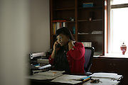 """DEMOPOLIS, AL – NOVEMBER 17, 2015: Kim Catlin, RN, works in her new office at the Tombigbee Healthcare Authority. Since 2007, Catlin worked with the Delta Rural Assistance Program (DRAP) in 18 counties, educating the rural population about diabetes using the """"Powered to Prevent"""" curriculum. """"It's been wonderful,"""" Catlin said, """"especially out in the rural areas where they have nothing, trying to get them to understand. It's helped tremendously."""" In September 2015, Catlin transitioned from working traveling frequently and working in the field to an administrative role with DRAP. """"Out there from the clinical point of view, all I could do was say, 'here's my report.' Now that I'm on the administrative side, I can actually help write these grants and do something about it. I'm hoping I can make a difference, because it's my passion."""" After decades of the relentless spread of diabetes in the United States, federal data now show that the number of new cases has finally started to decline. On December 1, 2015, the Centers for Disease Control and Prevention published figures showing three consecutive years of decline in new cases, between 2012 and 2014.<br /> CREDIT: Bob Miller for The New York Times"""