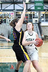 12 December 2015:  Maddie Merritt looks for a shot from the edge of the paint while defended by Allie Miceli during an NCAA women's basketball game between the Wisconsin Stevens Point Pointers and the Illinois Wesleyan Titans in Shirk Center, Bloomington IL