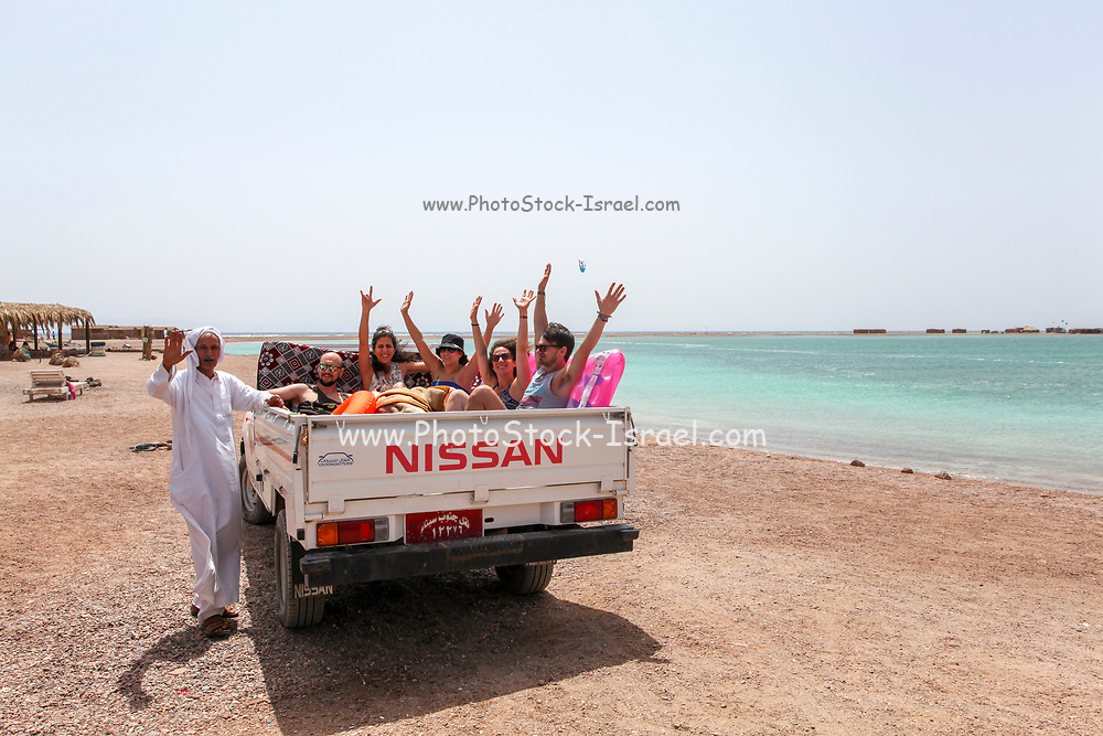 Local transport, Tourists  in a pickup truck. Blue Lagoon (Dahab), Sinai, Egypt