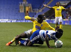 Birmingham City's Viv Solomon-Otabor and Reading's Andy Yiadom battle for the ball