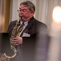 030515       Cable Hoover<br /> <br /> Saxophonist Riachard Wade performs during a reception Thursday at the Hilton Garden Inn in Gallup.