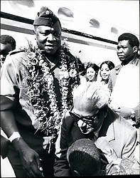 Jul. 07, 1976 - OAU Conference Mauritius: President Idi Amin of Uganda arrives here to attend the OAU meeting garlanded by his host Sir Seewoosagur Ramgoolam Prime Minister of Mauritius (in foreground). Credits: Camerapix (Credit Image: © Keystone Press Agency/Keystone USA via ZUMAPRESS.com)