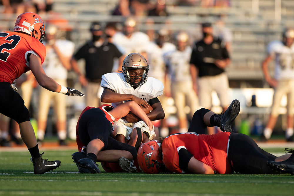 LaPorte defenders makes the tackle on Penn's Alec Hardrict during the Penn-LaPorte high school football game on Friday, August 28, 2020, at Kiwanis Field in LaPorte, Indiana.