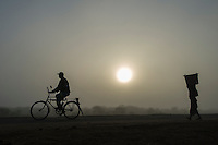 Cycling in the mist, Limpopo floodplain, Maputo Province, Mozambique