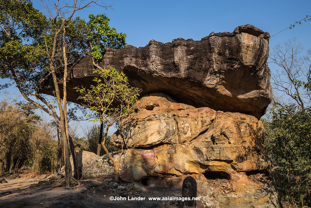 Phu Phra Bat is one of the premier attractions in Isaan although its location in rural Udon Thani province keeps the crowds at bay. Large boulders appear to balance on top of impossibly small rocks, rimmed by ancient Buddha images shrouded in legend. Phu Phra Bat combines a beautiful landscape along a forest trail speckled with religious arts going back over 3000 years. The park's huge mushroom shape rock formations were the result of erosion that took place when the terrain was under the sea millions of years ago. Narrow sandstone stems hold up the weight of harder and larger chunks of rock up above them. Similar formations can be seen at Pha Taem national park but those at Phu Phra Bat are more spectacular, as if defying the laws of gravity.  The most haunting set of stones is found at Kou Nang Usa, known as Thai Stonehenge.  Ranging in height from one to three meters, seven markers have stood through the centuries in a circle surrounding a jagged rock formation rising from a broad stone floor.