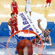 Anadolu Efes's Semih Erden, Dusko Savanovic (R) and Olympiacos's during their Turkish Airlines Euroleague Basketball Group C Game 2 match Anadolu Efes between Olympiacos at Abdi ipekci Arena in Istanbul, Turkey, Friday, October 19, 2012. Photo by TURKPIX
