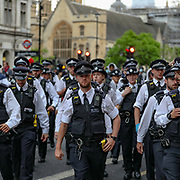 Police retreats near the Downing Street during a demonstration in Parliament Square in London on Wednesday, June 3, 2020, over the death of George Floyd, a black man who died after being restrained by Minneapolis police officers on May 25. Protests have taken place across America and internationally after a white Minneapolis police officer pressed his knee against Floyd's neck while the handcuffed black man called out that he couldn't breathe. The officer, Derek Chauvin, has been fired and charged with murder. (Photo/ Vudi Xhymshiti)