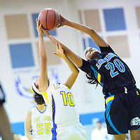 012114  Adron Gardner/Independent<br /> <br /> Navajo Prep Eagle Jasmine Coleman (20),right, out reaches Zuni Thunderbird Rani Yamutewa (10) for a rebound in Zuni Tuesday.