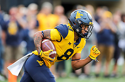 Sep 22, 2018; Morgantown, WV, USA; West Virginia Mountaineers wide receiver Marcus Simms (8) receives a kickoff during the first quarter against the Kansas State Wildcats at Mountaineer Field at Milan Puskar Stadium. Mandatory Credit: Ben Queen-USA TODAY Sports