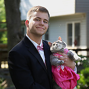 Student Couldn't Find A Date For Prom So He Took His Cat Instead<br /> <br /> Finding a date for Prom can be a stressful experience for many. Just ask Sam Steingard. With the big date drawing ever nearer, the 18-year-old singleton from The States still hadn't found a girl to take. So instead of going alone or refusing to go at all, he did what any rational and sound-minded person would do in such a situation. He took Ruby, his cat.<br /> Ok, so he didn't take his cat to the actual dance (as it might have been too stressful for her) but he did at least pose for some prom photos with her. They might not have gone to prom together but they still make a pretty cute couple!<br /> ©Exclusivepix Media