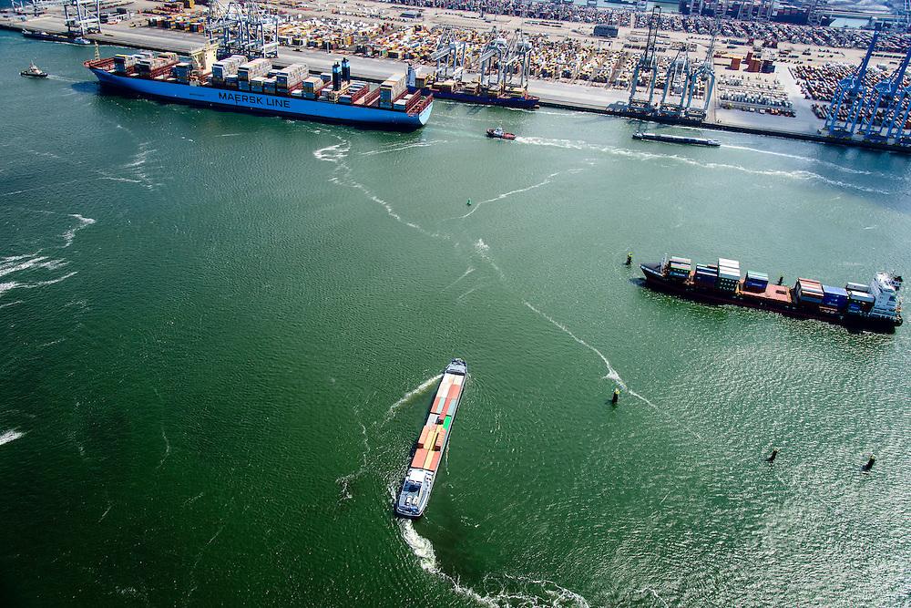 Nederland, Zuid-Holland, Rotterdam, 10-06-2015; Container Ship Morten van Maersk Line verlaat de APM terminal aan de Europahaven op de Maasvlakte. Het schip is onderweg naar open zee en wordt geassisteerd door twee sleepboten van Iskes. In de voorgeond binnenvaartschip en coaster, beiden beladen met containers.<br /> Containership Morten Maersk Line leaves the APM terminal at the Europe harbour on the Maasvlakte. The ship is on its way to open sea and is assisted by two tugs from Iskes.<br /> <br /> luchtfoto (toeslag op standard tarieven);<br /> aerial photo (additional fee required);<br /> copyright foto/photo Siebe Swart