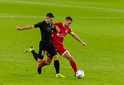 CARDIFF, WALES - Wednesday, August 19, 2020: Connah's Quay Nomads' George Horan (R) and FK Sarajevo's Mirko Oremuš during the UEFA Champions League First Qualifying Round match between Connah's Quay Nomads FC and FK Sarajevo at the Cardiff City Stadium. FK Sarajevo won 2-0. (Pic by David Rawcliffe/Propaganda)