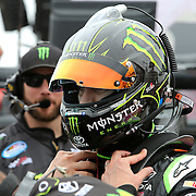 Racecar driver Kyle Busch is seen on the starting grid prior to racing in the NASCAR DRIVE4COPD 300 auto race at Daytona International Speedway on Saturday, February 22, 2014 in Daytona Beach, Florida.  (AP Photo/Alex Menendez)