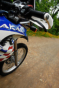 BMW F650 GS Dakar riding at speed down gravel road in SE Oklahoma.  Front wheel, depicts speed.