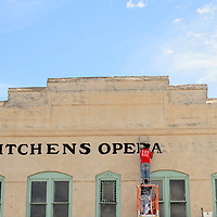 072114       Cayla Nimmo<br /> <br /> Ric Saracino paints the letters onto Kitchen's Opera House Monday afternoon in downtown Gallup.