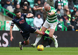 Celtic's Scott Brown (right) challenges Ross County's Ryan Dow during the Scottish Premiership match at Celtic Park, Glasgow.