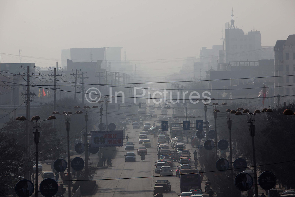 Traffic moves through thick haze in Linfen, Shanxi Province, China on Thursday, 03 December, 2009. Due to the heavy presence of coal mines and related industries, Linfen was named the world's most polluted city from 2004-2007.