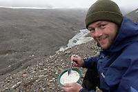 Man eating food outdoors, Svalbard