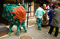 At various festivals around the Japanese Islands, shishimai dances are performed to consecrate the festival ground and open the festival. A wooden lion mask and wooly-looking costume of woven and dyed banana/choma strips is worn, and the dance is performed to loud music featuring gongs, drums, bells, flutes, sanshin, and various other instruments. Some lion dances feature two or more dancers as the lion.