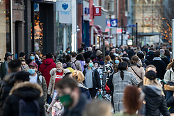 © Licensed to London News Pictures. 19/12/2020. Manchester, UK. Busy with shoppers on Market Street, Manchester as the city is busy for the last weekend before Christmas. Photo credit: Kerry Elsworth/LNP