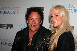 June 30, 2012 - San Francisco, California, U.S. - NEAL SCHON guitarist for Journey and girlfriend MICHAELE SALAHI arrive at San Francisco International Film Festival's closing night premiere of 'Don't Stop Believin': Everyman's Journey' the documentary by R. Diaz that chronicles the unlikely true life story of Filipino cover band singer A. Pineda's discovery on YouTube to becoming the lead singer for Journey, one of the best selling classic rock bands of all-time..(Credit Image: © Tim Wagner/ZUMAPRESS.com)
