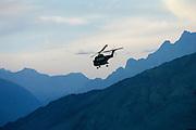 Military Helicopter in flight in Hunza region of Karokoram Mountains, Pakistan