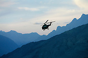 Military Helicopter in flight in Hunza region of Karokoram Mountains, Pakistan