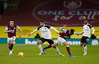 Football - 2020 / 2021 Premier League - Burnley vs. Fulham<br /> <br /> Ruben Loftus-Cheek of Fulham steps past Matthew Lowton of Burnley as Ashley Westwood and Ademola Lookman of Fulham look on, at Turf Moor.<br /> <br /> <br /> COLORSPORT/ALAN MARTIN