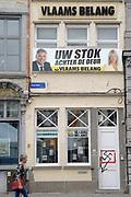 Mechelen is a city and municipality in the province of Antwerp, Flanders, Belgium.<br /> <br /> On the Photo:  Kantoor van Vlaams Belang (vaak afgekort als VB) is een Vlaams-nationalistische en rechts-conservatieve politieke partij / Office of Vlaams Belang (often abbreviated as VB) is a Flemish nationalist and right-wing conservative political party
