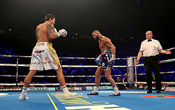 Tony Bellew (right) in action against Oleksandr Usyk during their WBC, WBA, IBF, WBO & Ring Magazine Cruiserweight World Championship bout at Manchester Arena.
