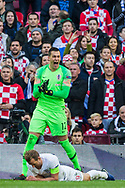 Lovre Kalinić (GK) (Croatia) with Harry Kane (Capt) (England) at his feet following attempt at goal during the UEFA Nations League match between England and Croatia at Wembley Stadium, London, England on 18 November 2018.