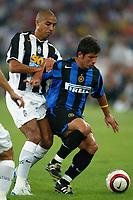 Bari 3/8/2004 Trofeo Birra Moretti - Juventus Inter Palermo. <br /> <br /> Belozoglu Emre Inter challenged by David Trezeguet<br /> <br /> Risultati / results (gare da 45 min. each game 45 min.) <br /> <br /> Juventus - Inter 1-0 Palermo - Inter 2-1 Juventus b. Palermo dopo/after shoot out <br /> <br /> Photo Andrea Staccioli