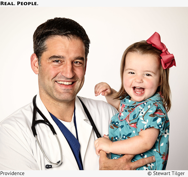 Providence Hospital doctor holding his baby.
