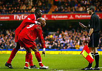 Photograph: Scott Heavey.<br /> Chelsea v Liverpool. FA Barclaycard Premiership.  07/01/2004.<br /> El-Hadji Diouf and Emile Heskey appeal to the linesman about the red card