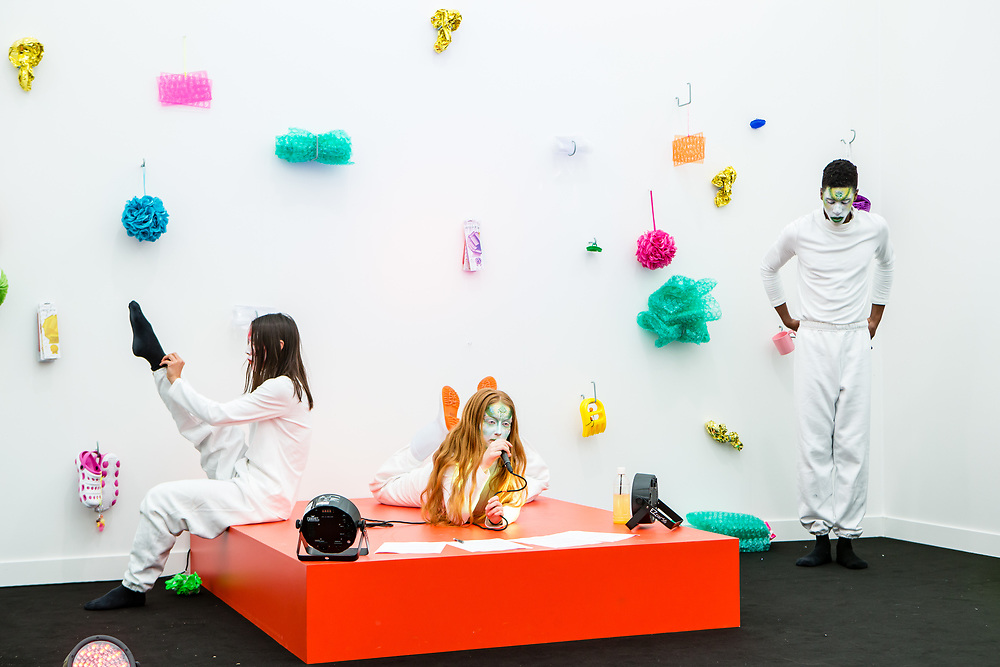 """New York, NY - 5 May 2017. The opening day of the Frieze Art Fair, showcasing modern and contemporary art presented by galleries from around the world, on Randall's Island in New York City. A performance piece by Ryan McNamara, """"Awareness Raising and Befriending Schemes,"""" part of the Frieze Projects."""