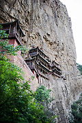 The Hanging Temple, also called Hanging Monastery or Xuankong Temple (simplified Chinese: 悬空寺 ; pinyin: Xuánkōng Sì), is seen in Datong, China, July 24, 2014.<br /> <br /> Confucianism, Taoism and Buddhism are the three major religions in China. Temples and statues witness their ancient roots all over the Chinese country.<br /> <br /> © Giorgio Perottino