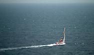 Roland Jourdain's yacht Sill makes progress through a grey Irish Sea during the Calais Round Britain Race.