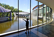 Hap Hall, 7, of Fayetteville Ark., looks outside from the East wing of Crystal Bridges Museum of American Art on Sunday, June 9, 2013, in Bentonville, Ark.