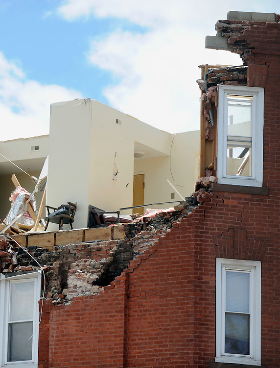 Storm damage a day after a tornado in Springfield, Mass., Thursday, June 2, 2011.  (AP Photo/Jessica Hill)