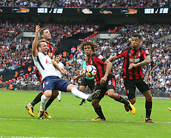 14 October 2017 Wembley: Premier League Football - Tottenham Hotspur v AFC Bournemouth: Harry Kane is pulled back by Ryan Gosling in the Bournemouth penalty area as Nathan Ake and Joshua King clear the danger.<br /> <br /> Photo: Mark Leech